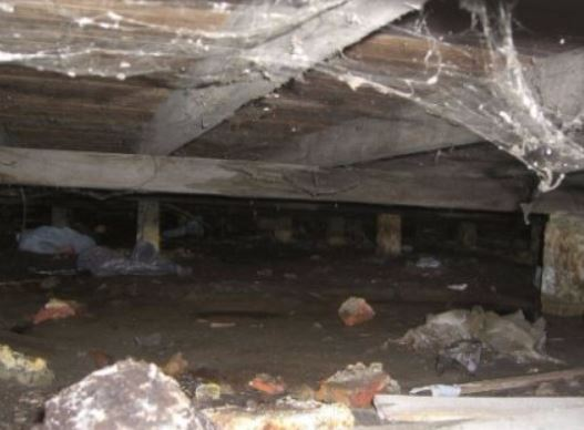 a picture of a dirty crawl space in walnut creek, ca
